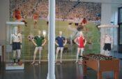 """Ausstellung """"Fussball-Fieber im tim"""" von links: Trikots von Jakob Streitle (1916 - 1982), Manuel Negrete Arias (* 1959) , Oscar Ruggeri (* 1962), Yousuf Hussain Mohammad (* 1965) und von Philipp Lahm (* 1983) Bildnachweis: tim"""