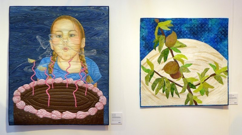 Cherrie Hampton: Make a Wish (li), Sarah Entsminger: Mother Nature's Milk SAQA Ausstellung 'Food for Thought' The Festival of Quilts 2015