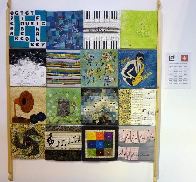 Die Beiträge aus der Schweiz EQA Ausstellung 'Music - with a touch of red' The Festival of Quilts 2015