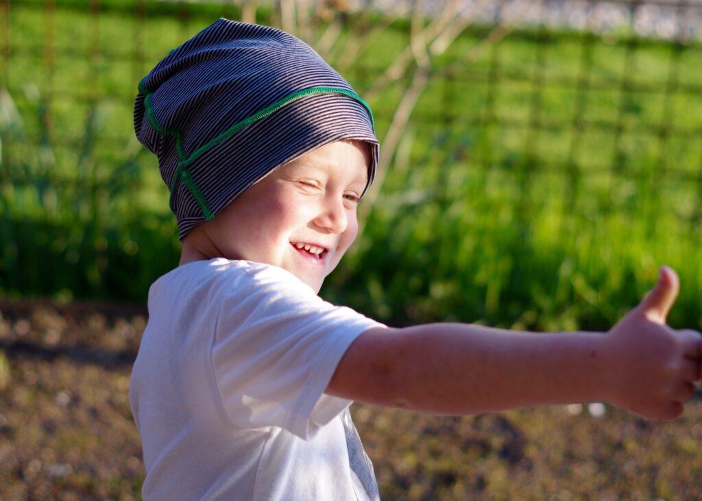 Kind mit Mütze