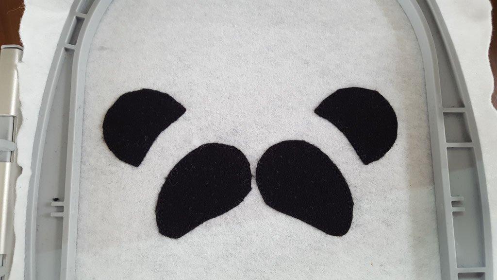 Man kann erahnen, dass es ein Panda wird.