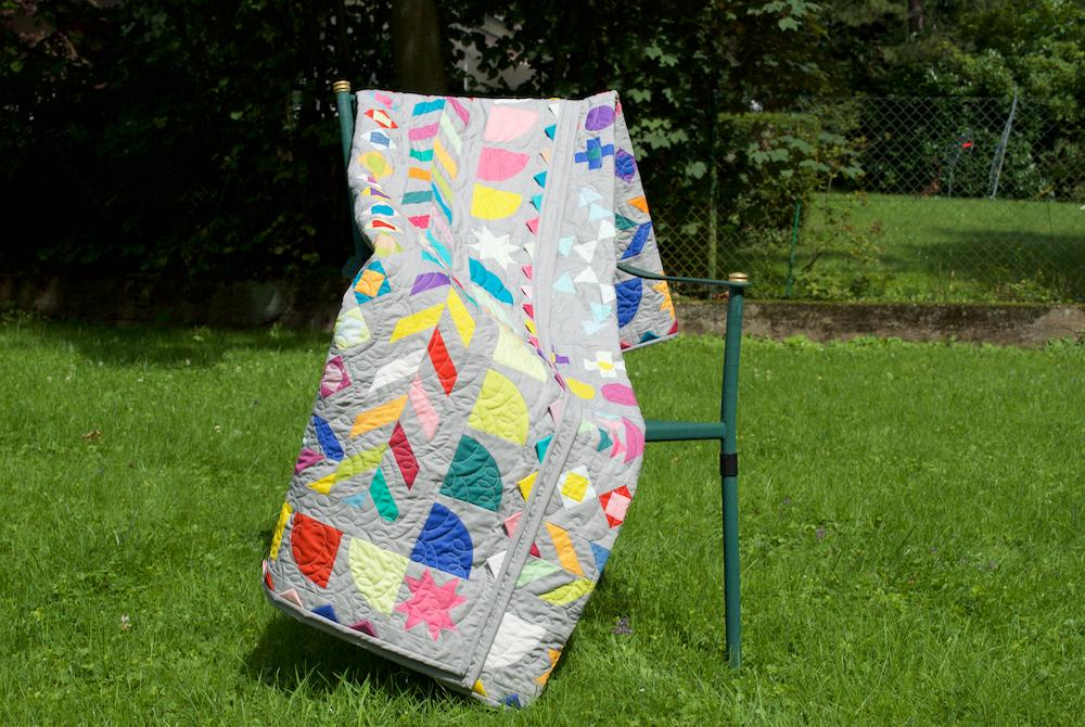 Medaillon Quilt mit Stuhl