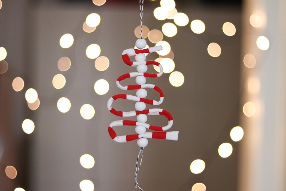 Jersey Pendant in Front of a String of Lights
