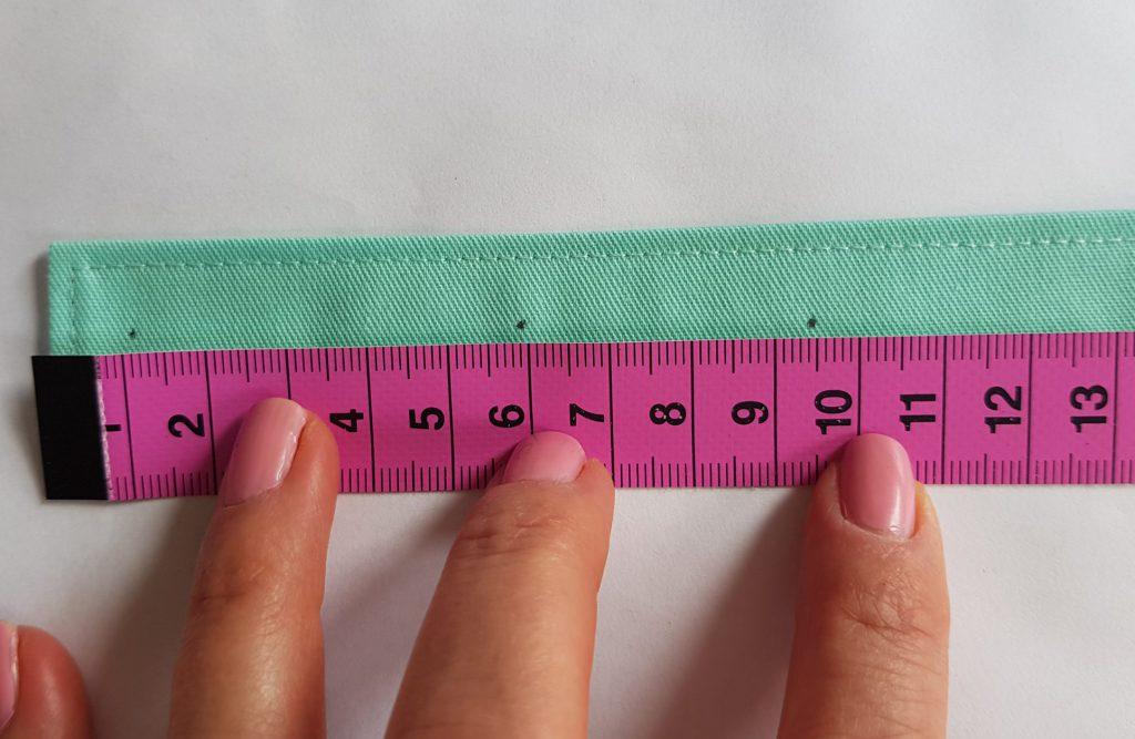 Markierung für Druckknöpfe links