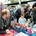 Stuart Hillard makes time to chat to young visitors from France