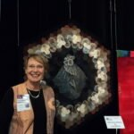 Tuula standing beside some of her work.  Tuula won Best in Show with her wonderful textile art.