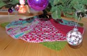 Sewing a beautifully embroidered quilted tree skirt