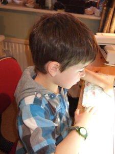 Euan-sewing-his-bag-3