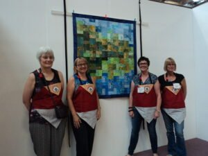 Why Not Quilters with the winning entry for Game of Quilts!