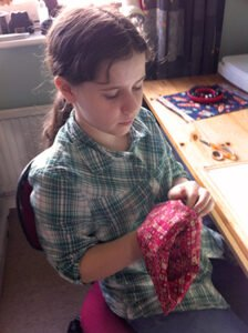 Caitlyn turning her pencil case right side out.