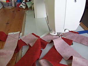 Chain piecing the mitred seams joining all the binding strips