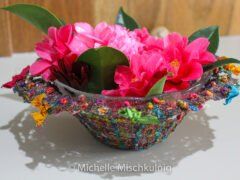 Withthw original glass bowl inserted back in it makes a beautiful posy vase.You can see the added emblishemnet in this image