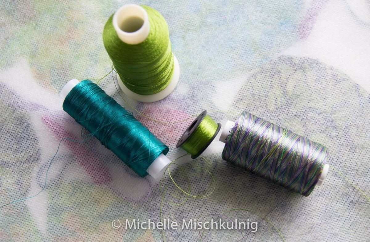 Choosing colours of rayon threads.