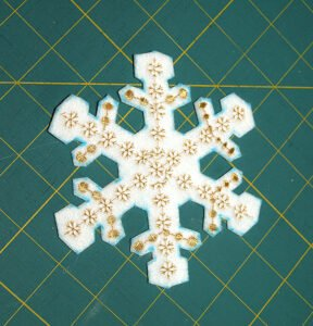 Snowflake cut out and ready to sponge to remove pen marks