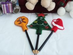 Sewing Christmas pencil toppers from felt remnants
