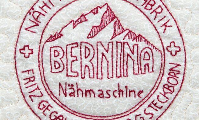 Detailfoto van het oude Bernina logo