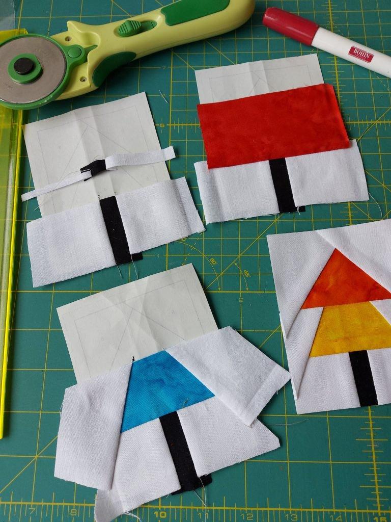 Diverse stappen van paper piecing voor de kerstboompjes