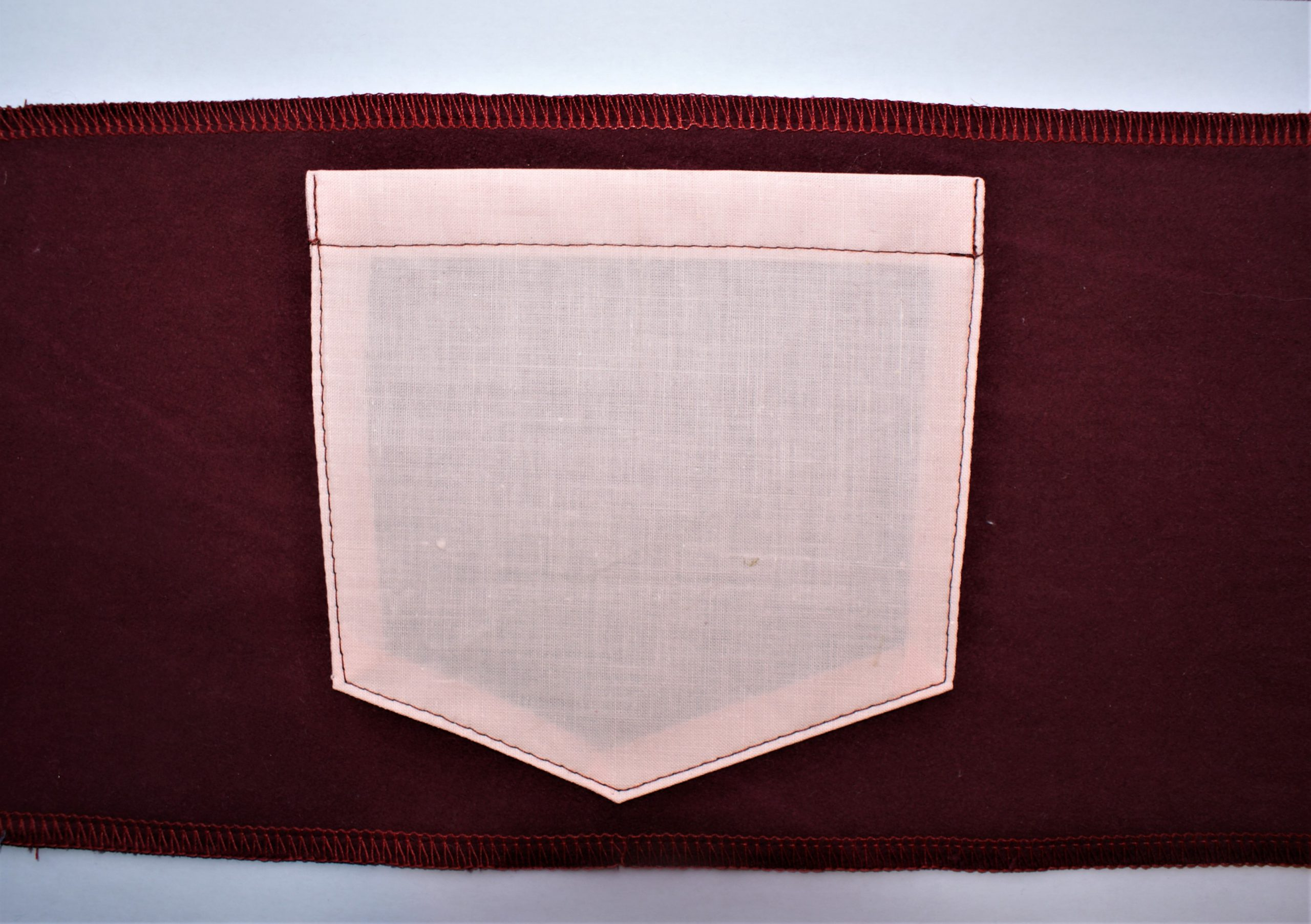 A pocket, neatly topstitched