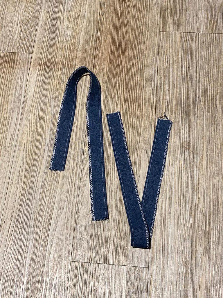 Twee genaaid hengsels van 14 x 60 cm