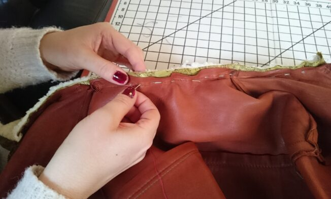 Pinning the neck area, with the new collar inserted between jacket and lining