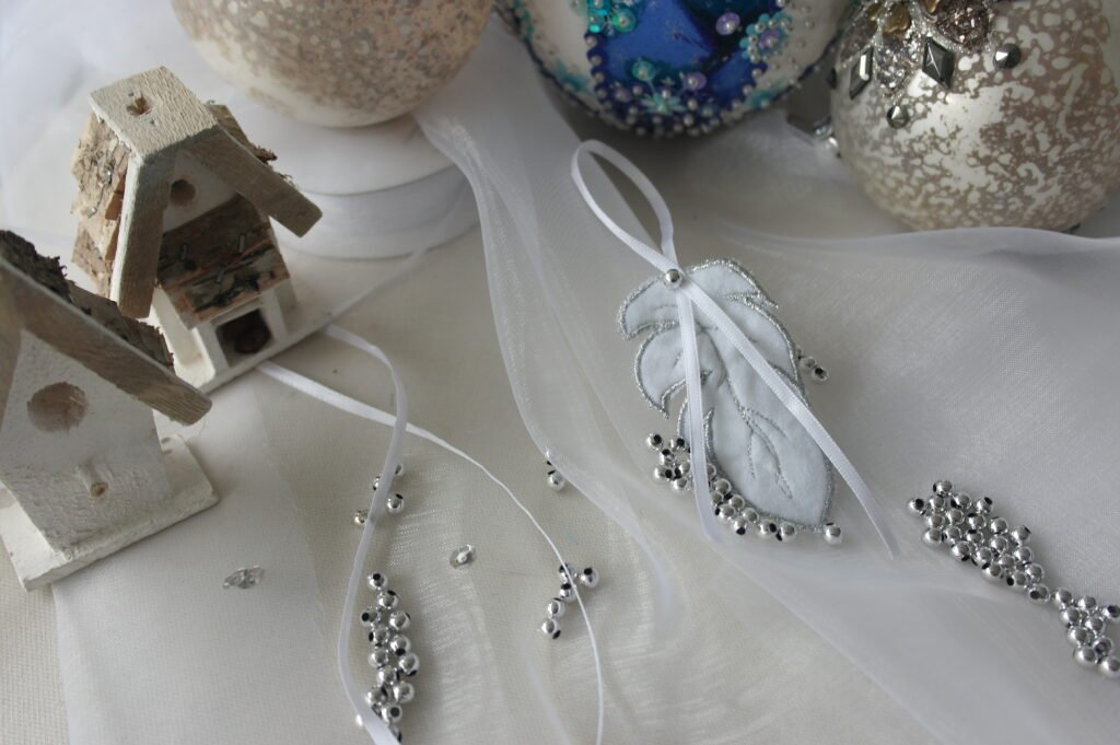 Easy instructions for creating festive feather pendants