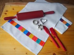 Sewing a dish towel out of old linen and fabric remnants